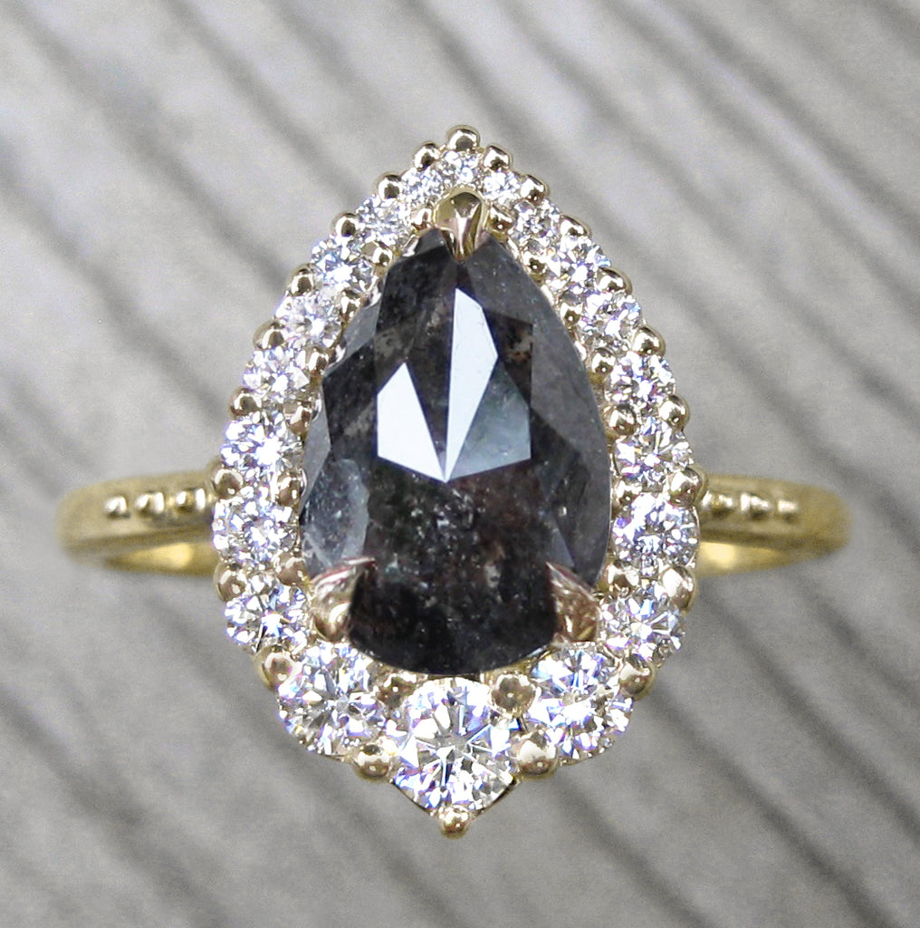 unique pear salt + pepper diamond engagement ring