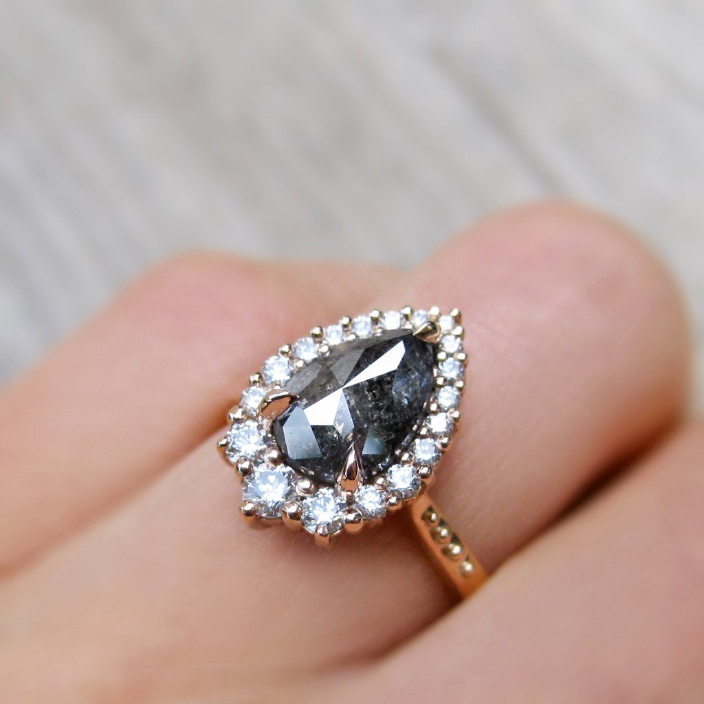 low-profile pear salt + pepper diamond engagement ring in rose gold