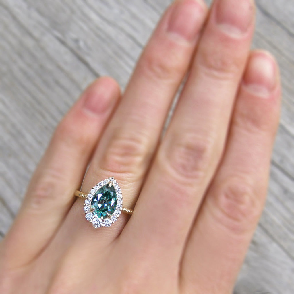 <center><strong>・CELESTE・</strong><br></center>Aqua-Teal Iconic™ Pear Moissanite Center, Diamond Halo (1.83ctw+)