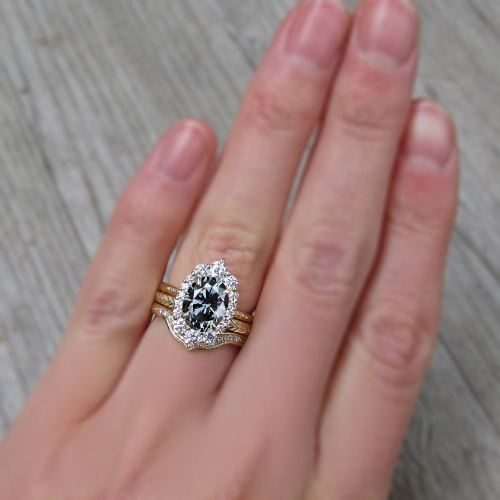 Oval conflict free diamond and grey moissanite halo ring with stacking bands
