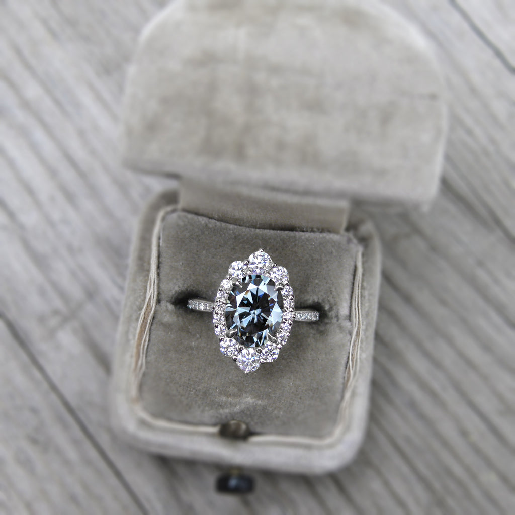 Vintage art deco style oval halo ring with grey moissanite and a diamond band