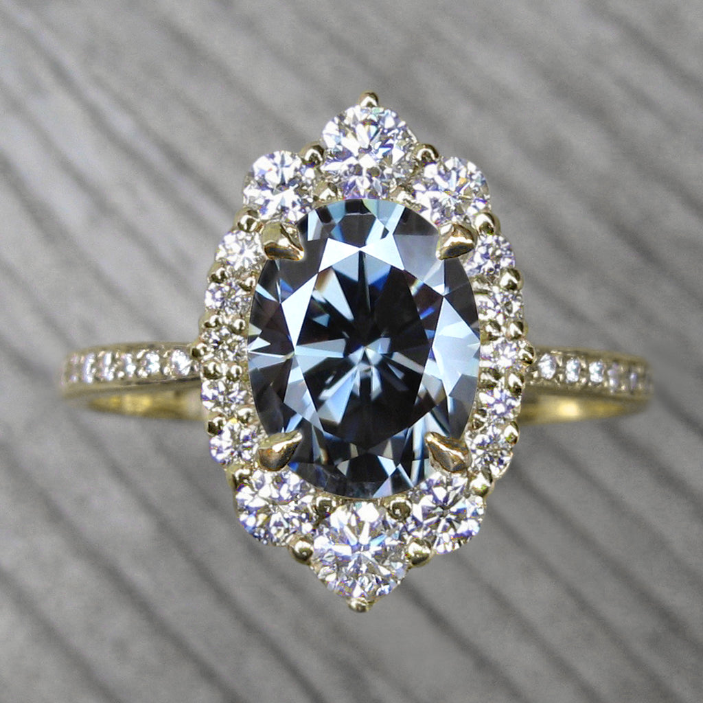 vintage inspired yellow gold halo with an oval grey moissanite