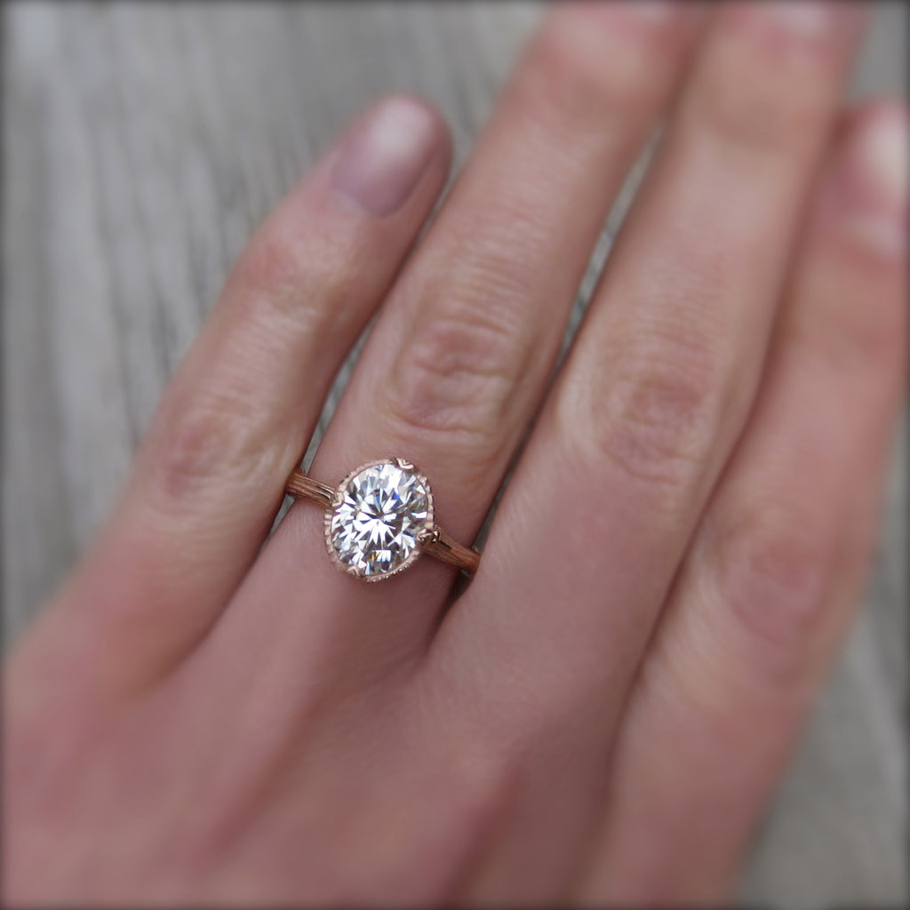 2ct Forever One oval cut moissanite engagement ring in 14k rose gold