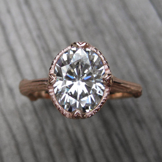2ct rose gold twig solitaire engagement ring with a Forever One oval cut moissanite