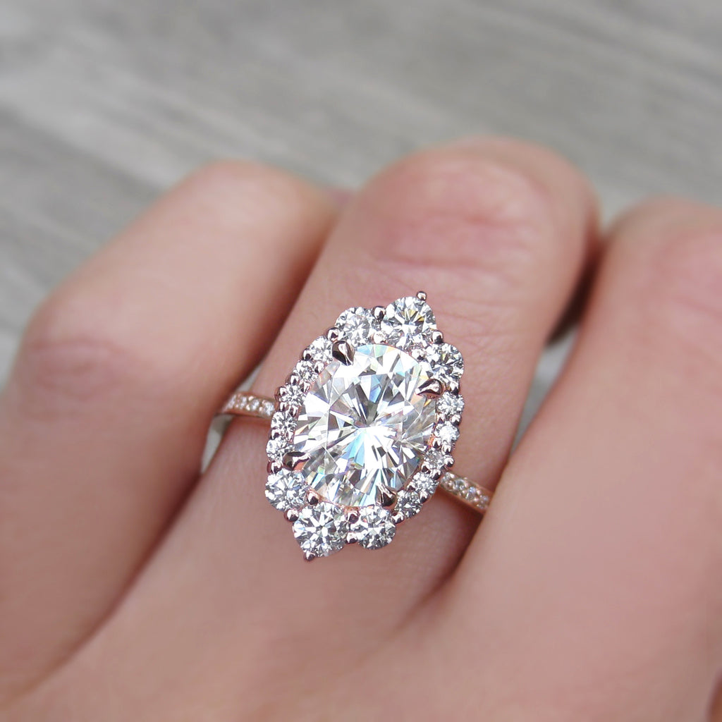 eco friendly oval moissanite halo ring with ethical diamonds and recycled gold