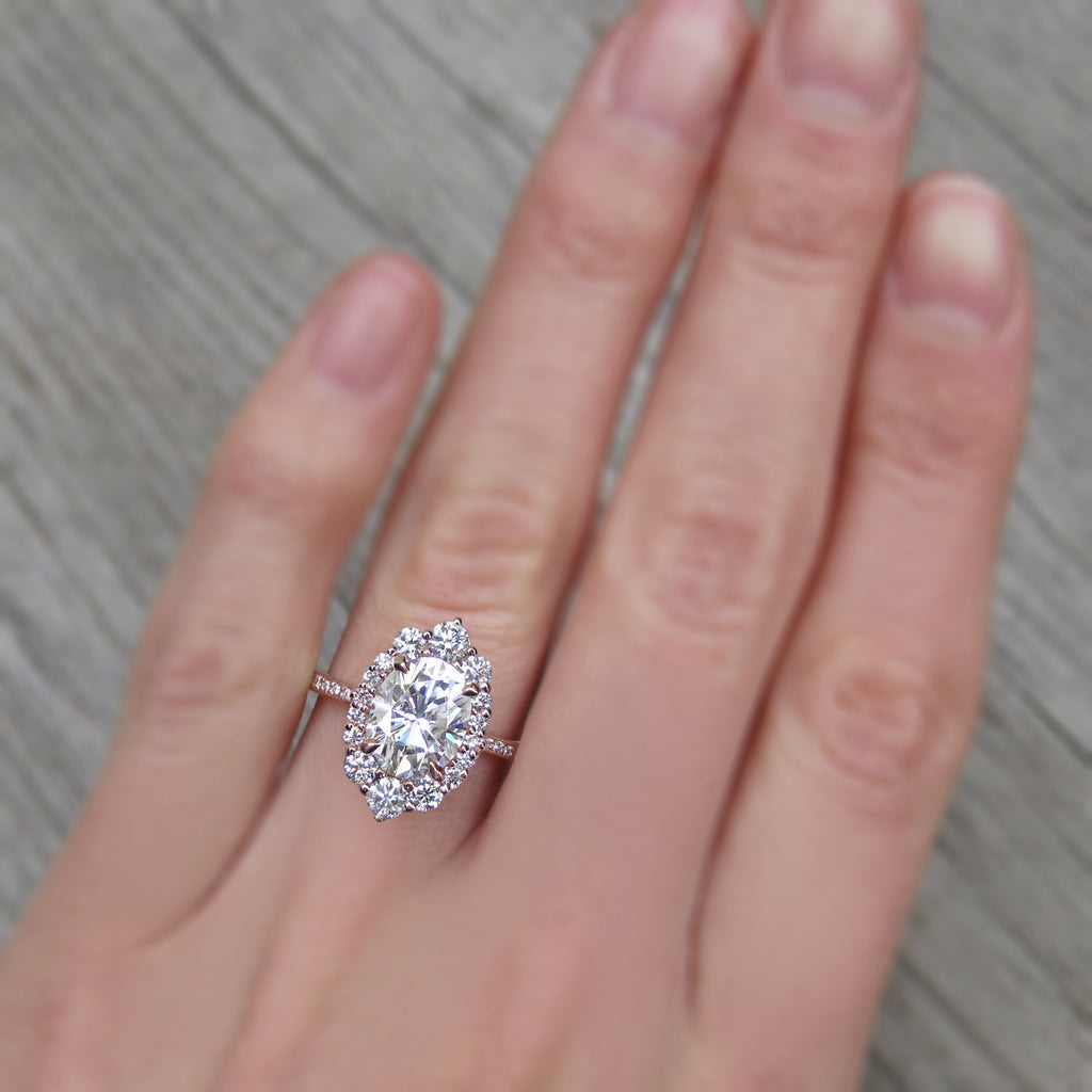 Rose gold Forever One moissanite halo engagement ring with conflict-free diamonds