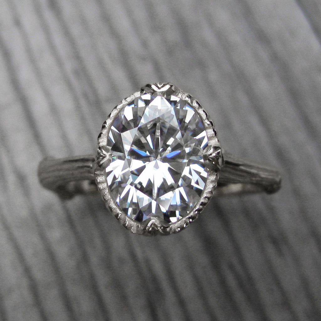 2ct white gold twig solitaire engagement ring with a Forever One oval cut moissanite