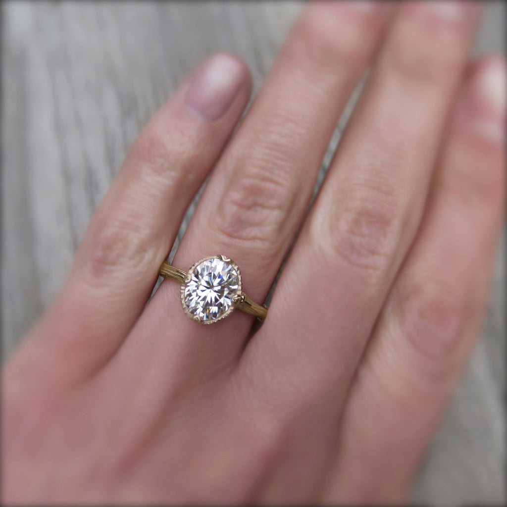 2ct Forever One oval cut moissanite engagement ring in 14k yellow gold