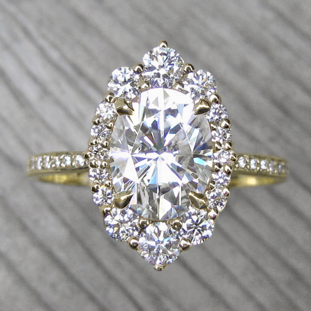Oval vintage moissanite halo ring + conflict-free diamonds in yellow gold