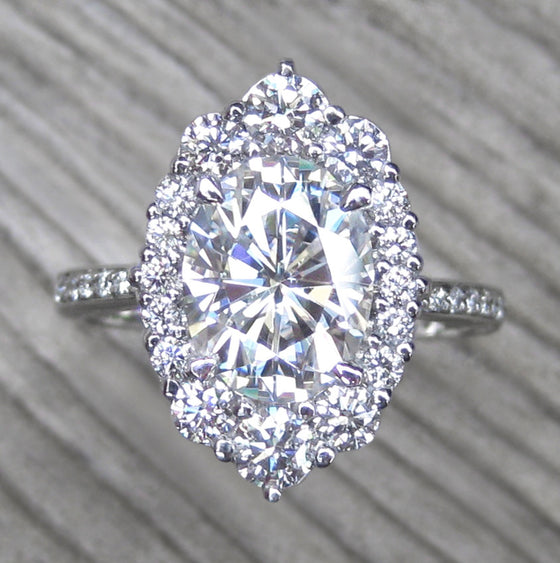 Oval vintage moissanite halo ring + conflict-free diamonds in white gold