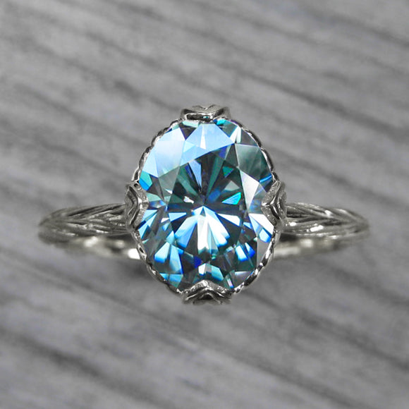 <center><strong>・OLIVIA・</strong><br></center> Oval Aqua-Teal Iconic™ Moissanite, Willow Leaves (2.1ct)