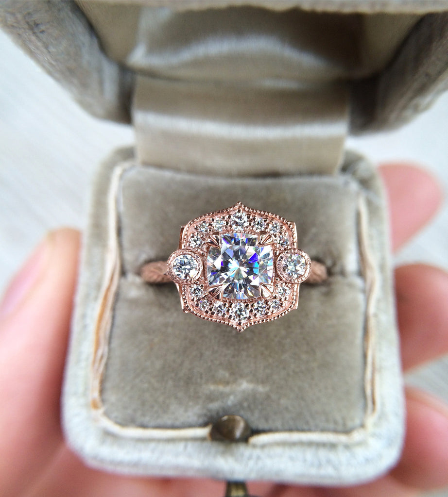 Cushion cut halo ring with ethical diamonds in 14k gold in engagement ring box