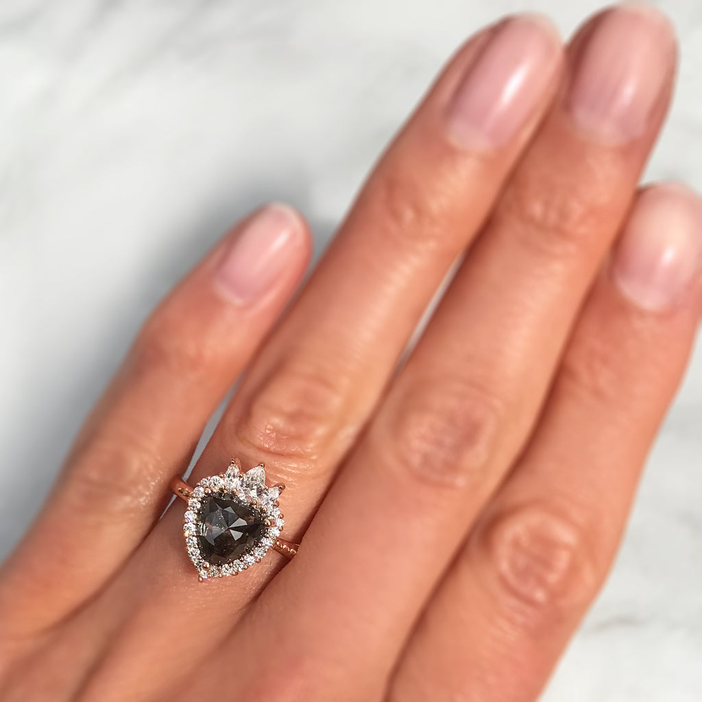 low-profile salt + pepper diamond halo engagement ring
