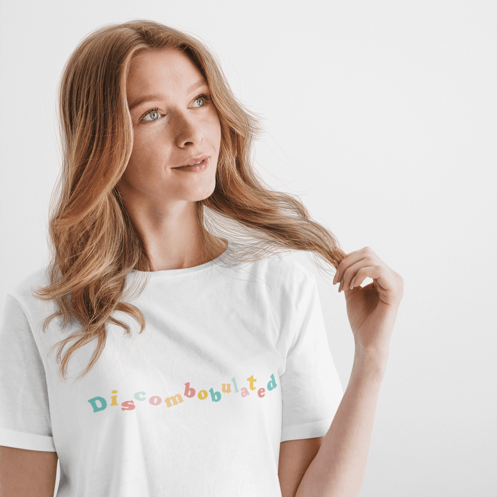 Woman with faraway look wearing a wit and wisdom discombobulated slogan tshirt