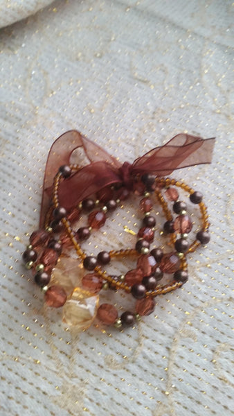 Acrylic/Plastic/Glass Stretch Bracelet in Amber/Gold/Brown