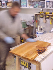 John finishing a solid cherry table top