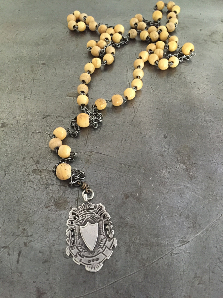 Vintage large Victorian double sided sterling fob on long vintage bone Rosary bead necklace