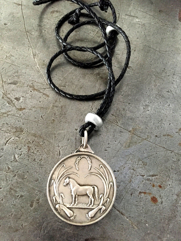 Vintage large sterling silver hallmarked horse medal on adjustable braided leather necklace