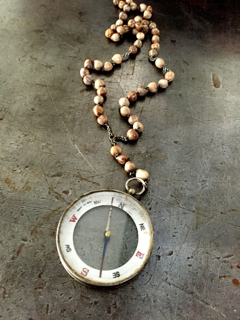 Vintage large double sided compass fob on vintage Rosary seed bead necklace.