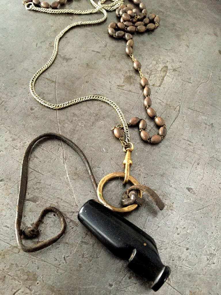 Vintage referee whistle with original leather piece on gold muff chain a WW1/WW2 brass rosary bead necklace