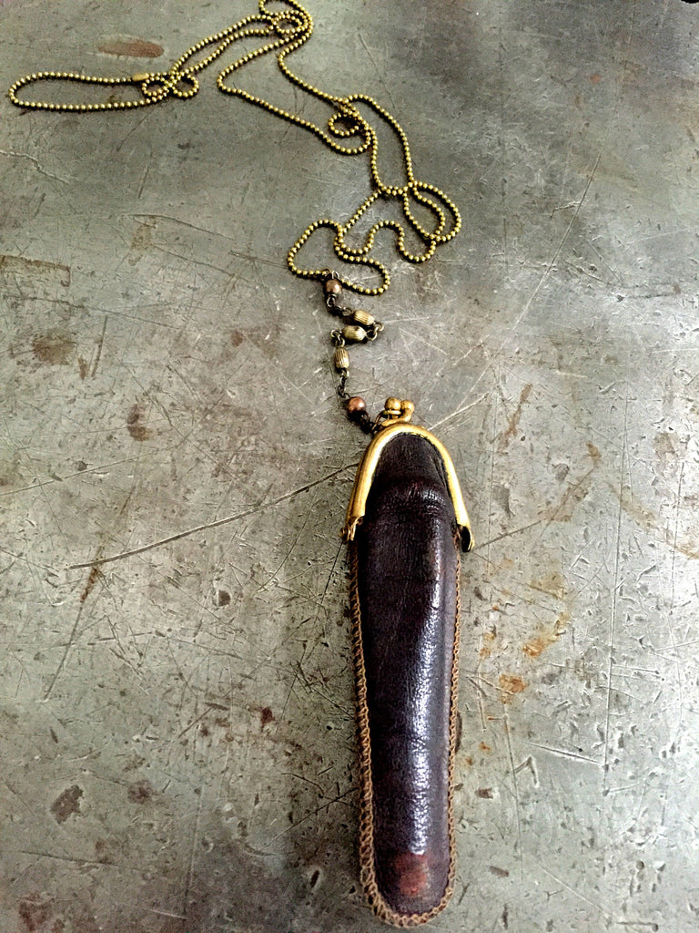 Vintage leather cigarette puch on vintage brass chain necklace