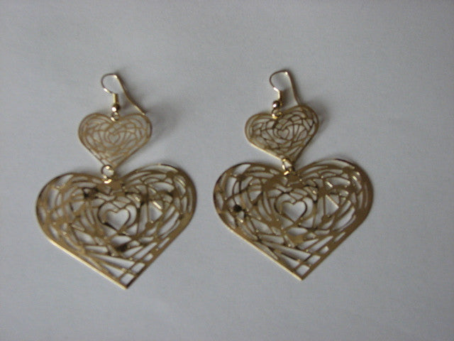 Gold toned heart shaped dangle earrings