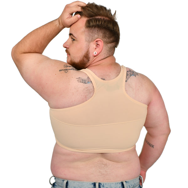 Model shows off a Nude No. 5 racerback binder, back to the viewer with one hand pushing back hair.