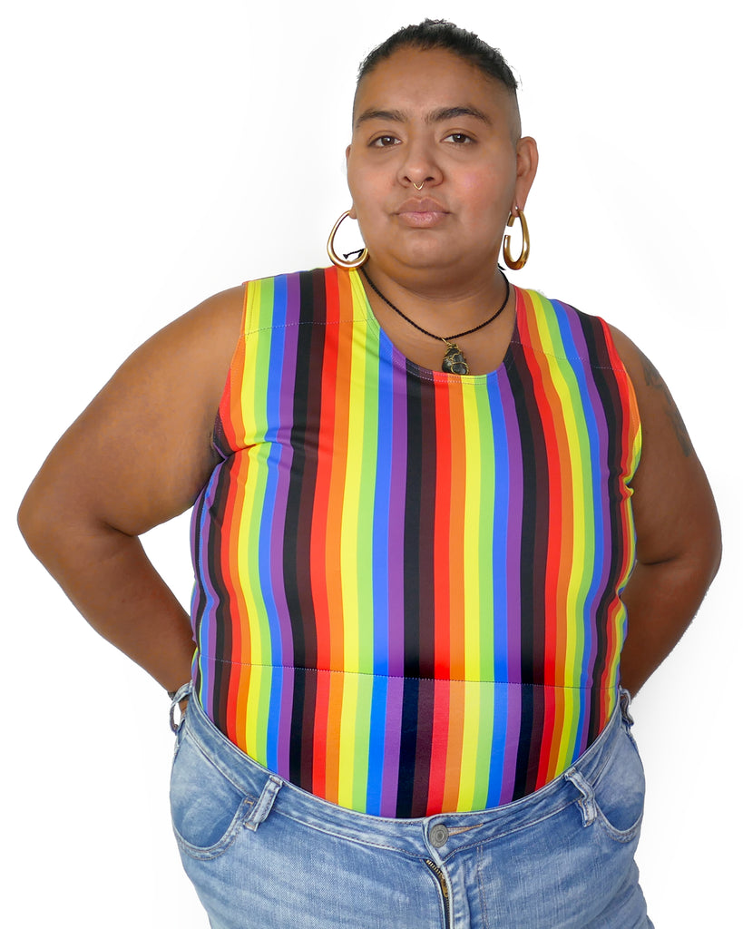 Person wearing More Color More Pride Binder, with Rainbow, Black and Brown vertical stripes.