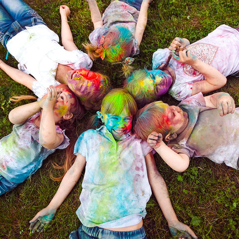 Childrens playing with colour powder in Canada