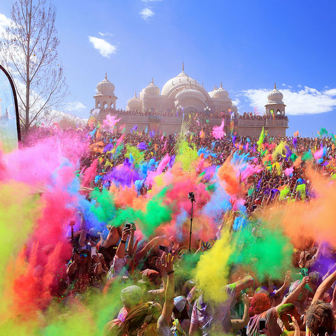 Holi festival in asia with people celebrating throwing colour powder