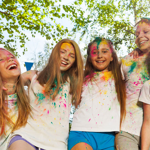 kids playing with colour powder at a school event