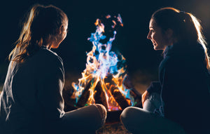 people around a fire using Tales and Magic product