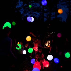 many people playing with luminous Balloons