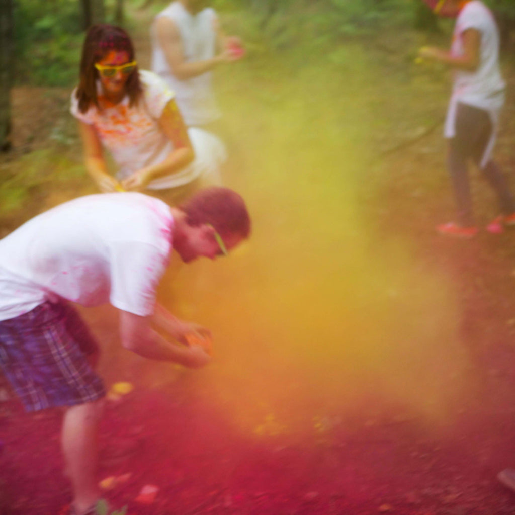 people playing with colour powder