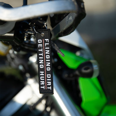 Flinging Dirt Getting Hurt - Dirt Bike Keychain