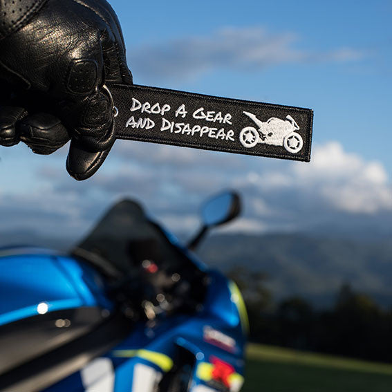 .BLACK AND WHITE. DROP A GEAR AND DISAPPEAR MOTORCYCLE KEYRING