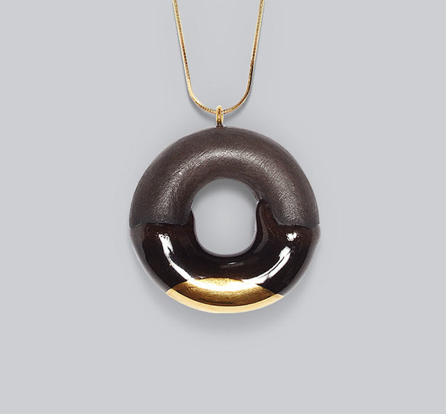 Gold glazed dark chocolate donut