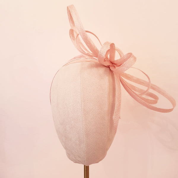 pink bow fascinator for wedding guests