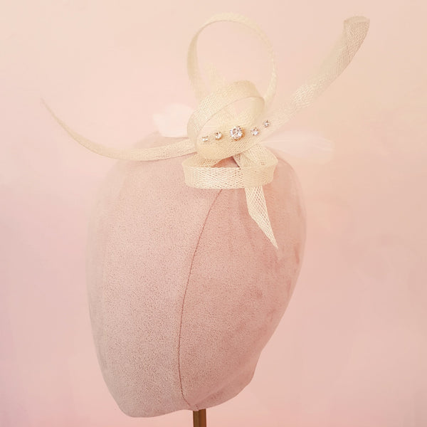 small ivory fascinator for wedding guests