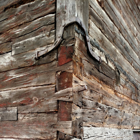 Metal bracing on old wooden building