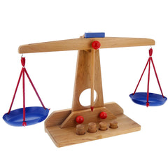 wooden scale with weights