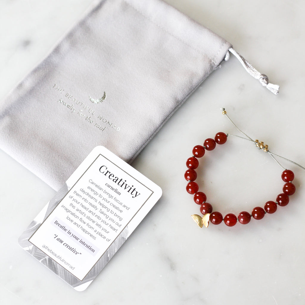 carnelian mala bracelet with butterfly charm and meaning card