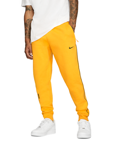 NOCTA NRG AU Fleece Pant ESS University Gold 1