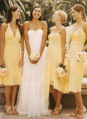 here the bridesmaids are wearing different styles but the same color