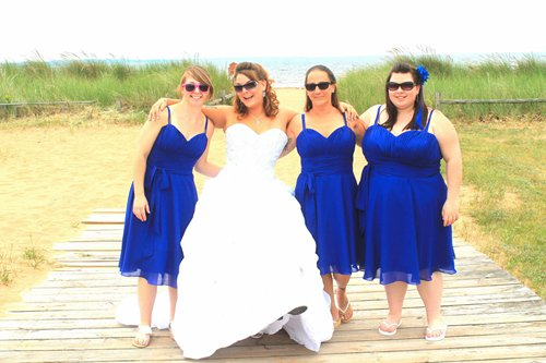 melissa and her bridesmaid's wearing their bridesmaid dresses