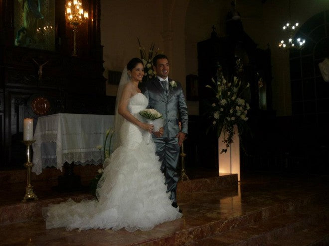 Here is Angelica posing in her wedding dress with her new husband - they look so happy together!