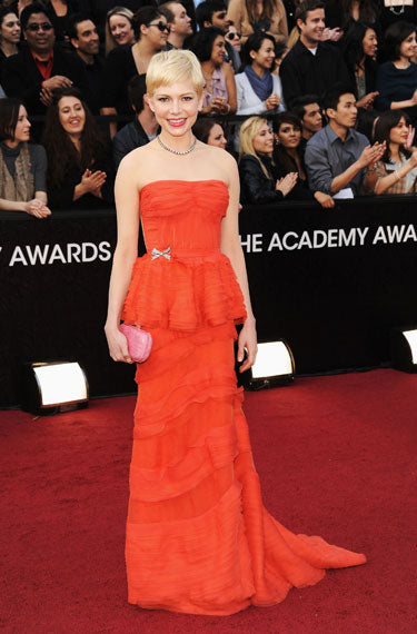 Michelle Williams in burnt orange LV gown