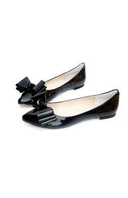 black patent flats with a bow
