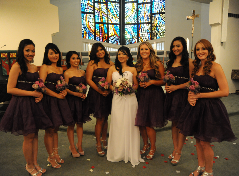 the bridal party posing in the church