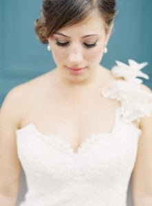 bride with updo wearing one shoulder wedding gowns